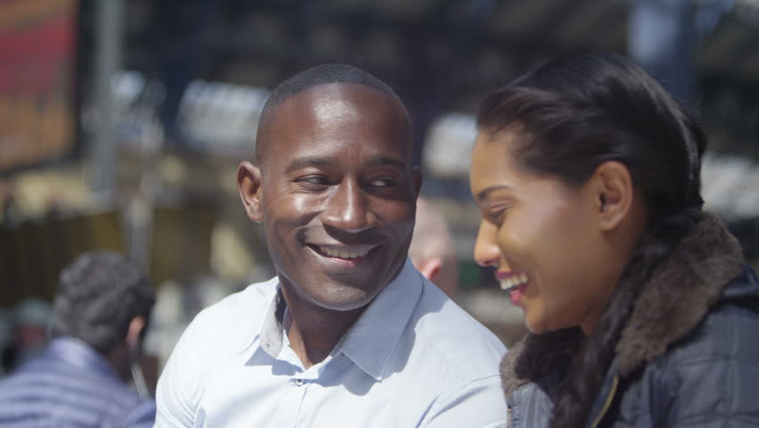 4k Happy attractive ethnic couple using computer tablet outdoors in the city   Shutterstock HD Video #15193141