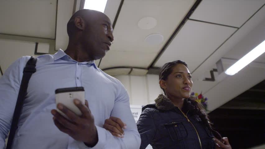 4k, happy African american tourists walking through subway underground station   Shutterstock HD Video #15194530