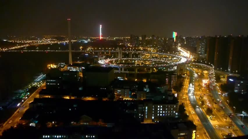 Panoramic of busy driving & cars racing by with streaking lights trail on overpass at night in shanghai,super long exposures,Brightly lit urban building,shipping sailing on huangpu river. gh2_07526 | Shutterstock HD Video #15200119