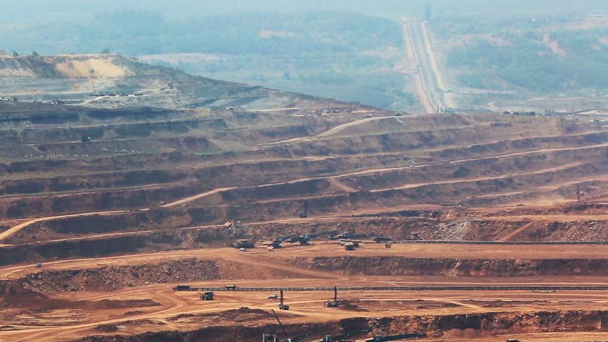 Mining dump trucks working in Lignite coalmine lampang thailand    Shutterstock HD Video #15201877