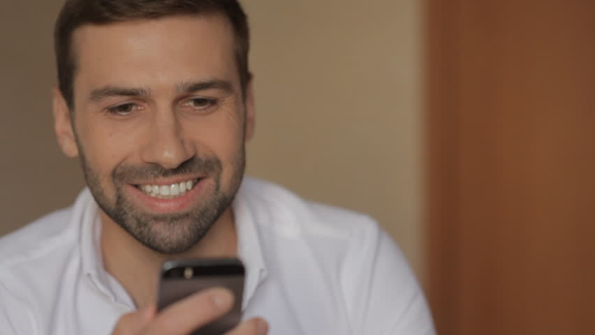 A young man is using a mobile phone | Shutterstock HD Video #15217984