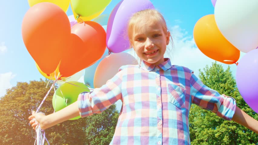 Closeup portrait happy girl spinning with balloons against the sky | Shutterstock HD Video #15220105
