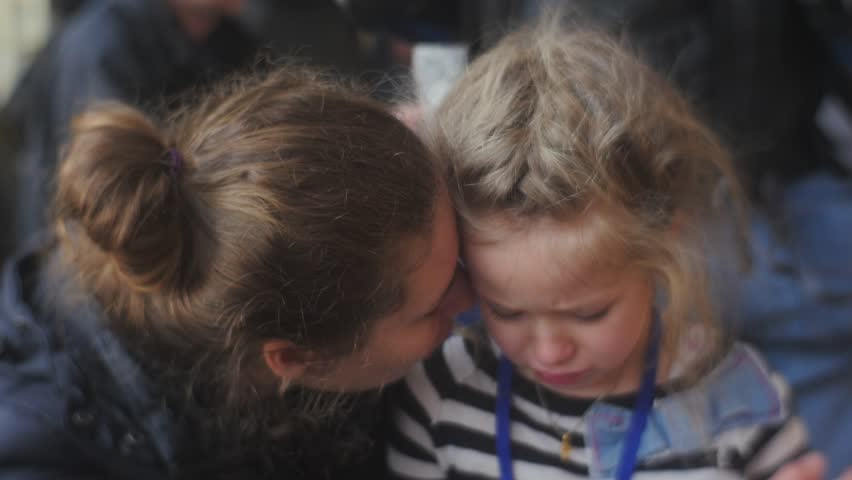 Woman Gives a Hug to Her Daughter and Smiling, Little Blonde Girl is Crying, Snuggling to Mom, Talking Something, Looking Somewhere, Tears Are Coming Down, Wet Face, Then Child Stops Crying  | Shutterstock HD Video #15223378