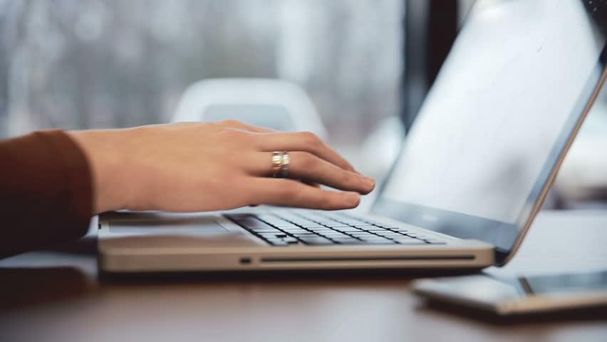 Businesswoman working on laptop in cafe. static  | Shutterstock HD Video #15225520