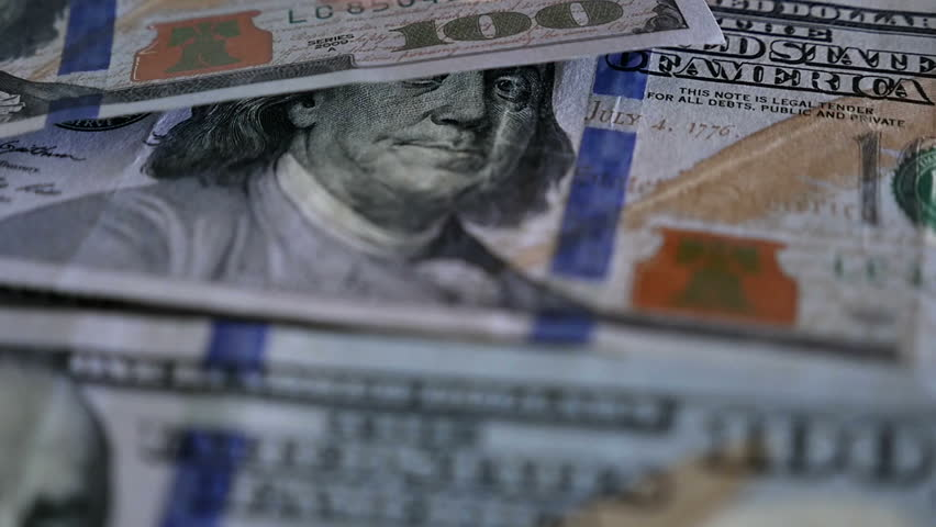 Close up of male hand picking up $100 bills one by one in slow motion. Shot with a Panasonic GH4 with a 12-35 mm 2.8 lens on white background.   | Shutterstock HD Video #15238021