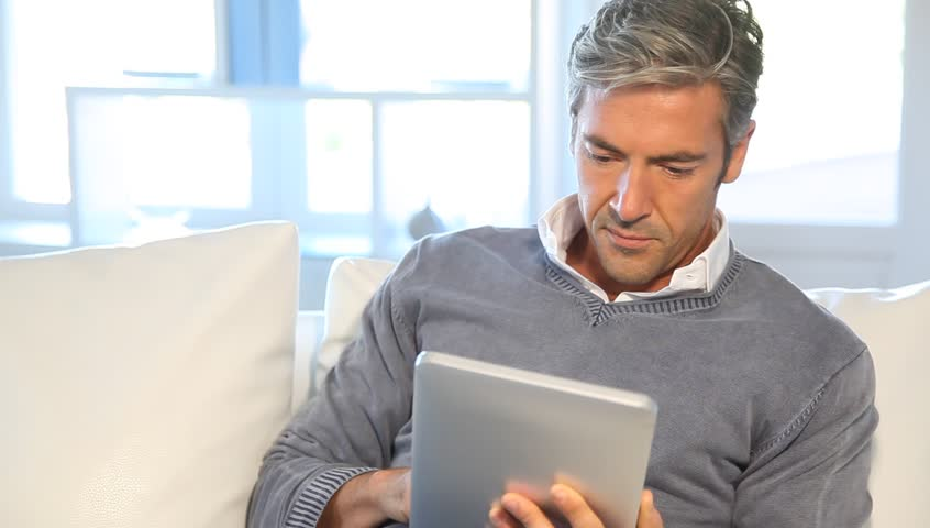 Man at home using electronic tablet | Shutterstock HD Video #1524017