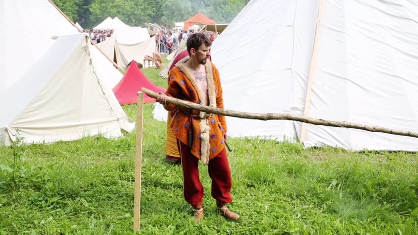 MOSCOW - JUNE, 6, 2015: Two men in robes of ancient people make fence on historical festival in Kolomenskoye. Kolomenskoye is state art and historical, architectural and landscape museum-reserve. | Shutterstock HD Video #15244162
