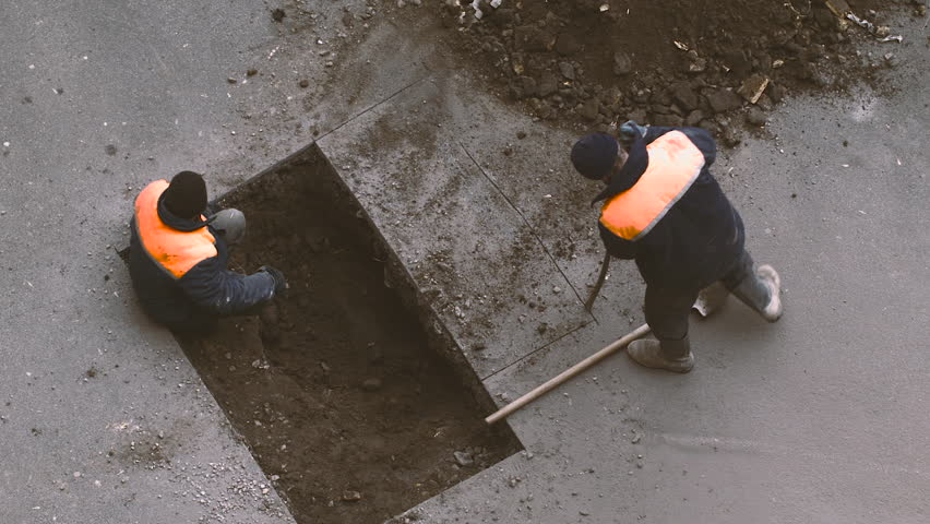 Two Workers Removed the Layer of Asphalt From the Road and Are in the Hands of a Shovel Rake Land of the Hole Under the Asphalt, the Asphalt is Cut, the Workers in the Form of Construction Tools | Shutterstock HD Video #15247375