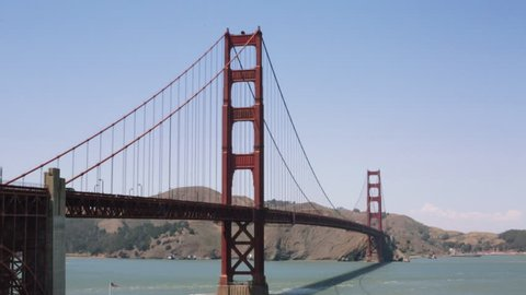 Tilt shot of the Golden Gate bridge on a sunny summer day in San Francisco, CA