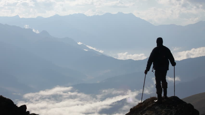 The traveler, mountains and clouds | Shutterstock HD Video #1527668