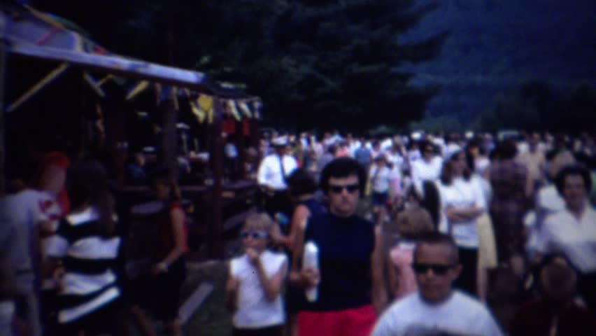 MONTICELLO, NEW YORK 1962: Country fair crowd amusement rides carnival games. #15288097