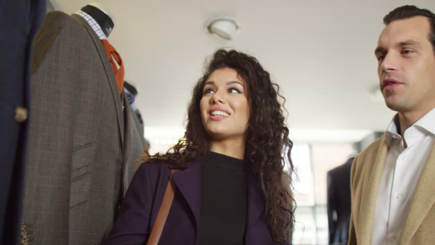 4K Attractive couple shopping for new suit in a man's clothing store | Shutterstock HD Video #15289066