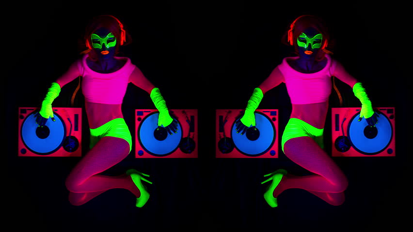 4k sexy female DJ mixes in a club in UV fluorescent costume. stylish,  cool and unique clip for events, parties and shows | Shutterstock HD Video #15304588