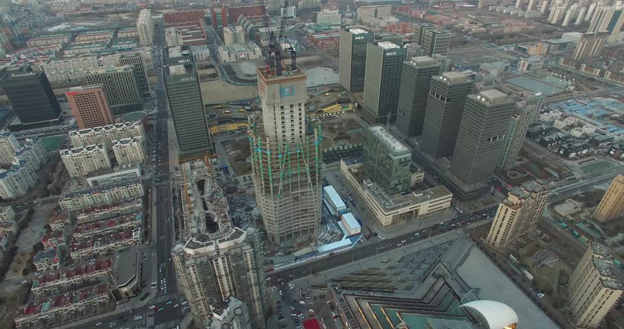 CINEMATIC AERIAL OF TIANJIN SKYSCRAPER UNDER CONSTRUCTION IN CHINA - CITYSCAPE #15312151