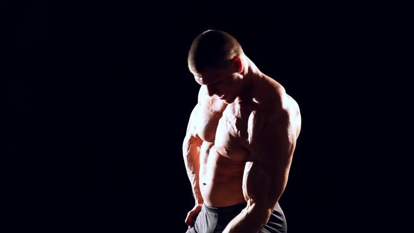 Bodybuilder doing dumbbell bench press   Shutterstock HD Video #15313408