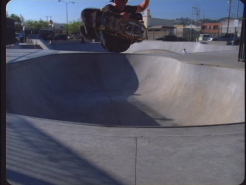 VENTURA, CA - CIRCA 2006: A boy in a city park makes a fancy jump with his skateboard circa 2006 in Ventura. The Pacific skatepark is one of three free parks in Ventura - the rest of the family includes Ventura's West and Hobart skateparks.