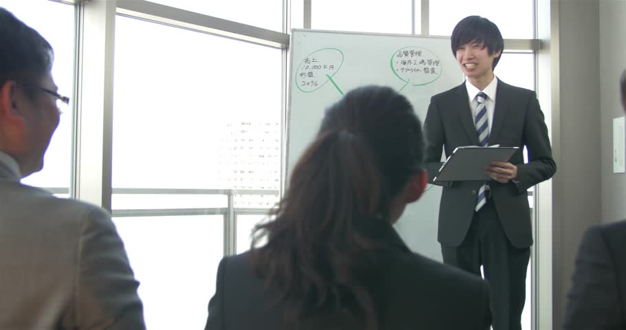 Young Japanese businessman makes a presentation to the team  | Shutterstock HD Video #15318934