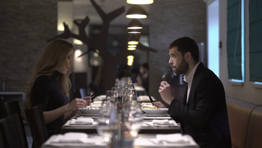 Couple in a restaurant is eating salad | Shutterstock HD Video #15319672