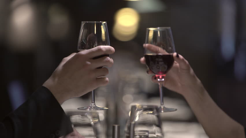 Woman and man, toast, clinking with wine glasses in a restaurant in the evening. UHD 4K #15320311