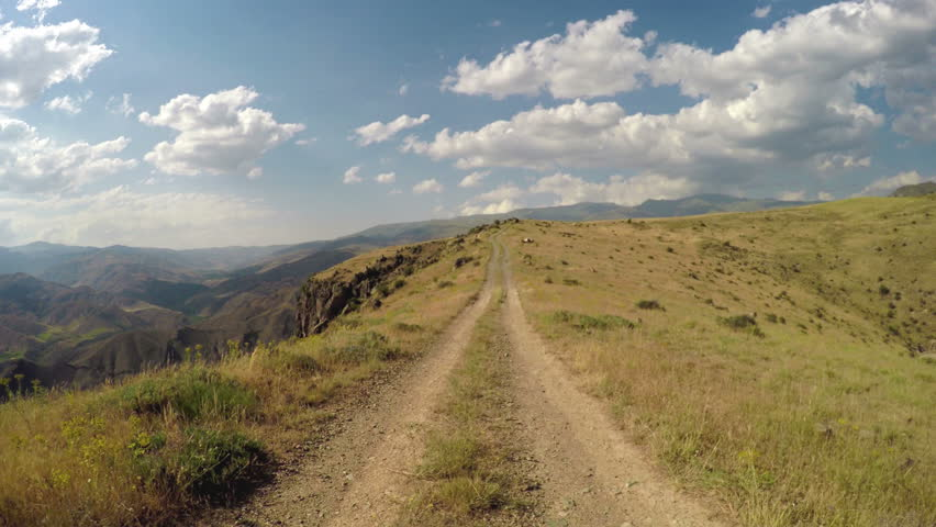 Off-road riding on a mountainous road with gorgeous view