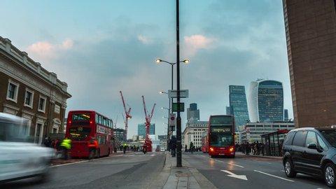 London, UK - MARCH 10, 2016: London Bridge, Day to Night Time-Lapse. Day to Night time lapse on the London Bridge with the view of the City of London with long shutter speed.