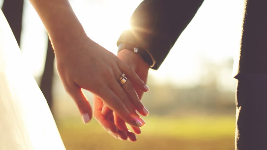 Marry Me Today And Everyday. Newlywed Couple Holding Hands, Shot In Slow Motion Bridesmaid, closeup, hand, male, together, wedding rings, people, married, bridal, Ring hand, closeup, outdoors, bouquet