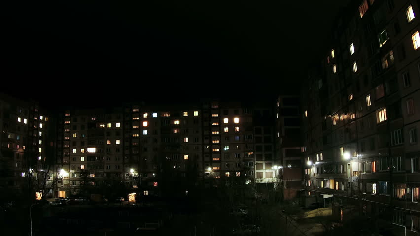 Time lapse of multistorey building with changing window lighting at night. | Shutterstock HD Video #15338416