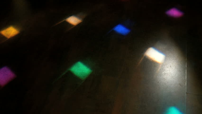 Disco light flashing different colors on the floor