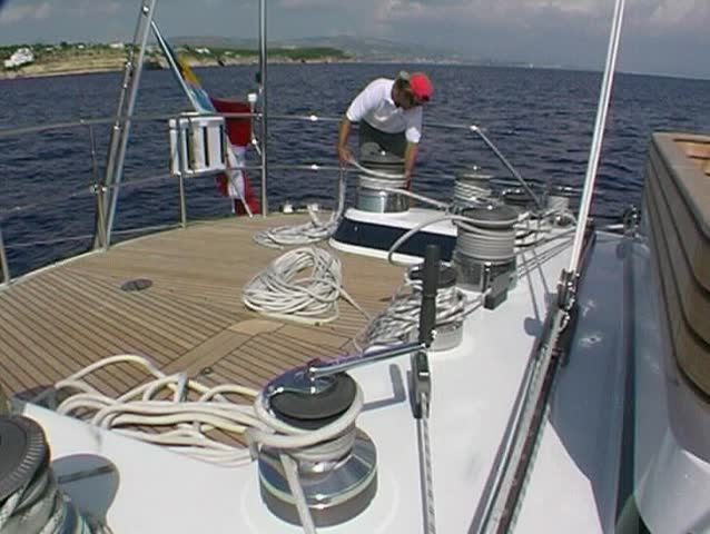Sailing yacht, crewman at the winch