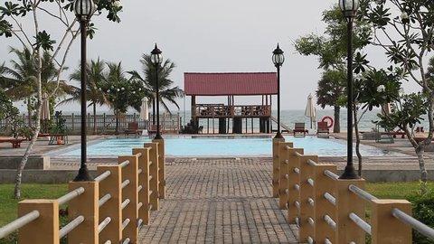 Video Swimming pool on the beach of a tropical island hotel Ametist. Passekudaha, Sri Lanka, 19 march 2014