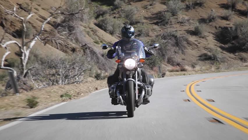 A man rides a motorcycle down a mountain road circa 2009 in Ojai.