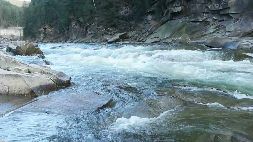 River in stony shores | Shutterstock HD Video #15389107