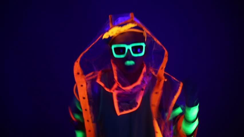 Guy dancing in neon costume | Shutterstock HD Video #15394861
