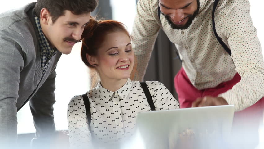 Close up of young creative team discussing plans and high-fiving in office meeting | Shutterstock HD Video #15413713