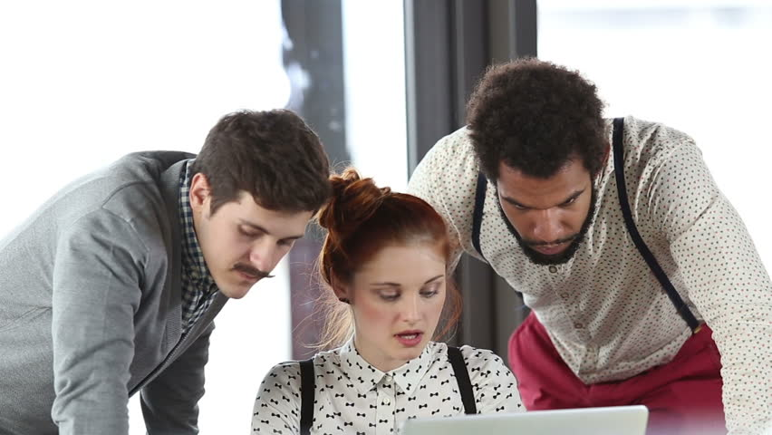 Close up of young creative team discussing plans in office meeting, slow motion | Shutterstock HD Video #15413938