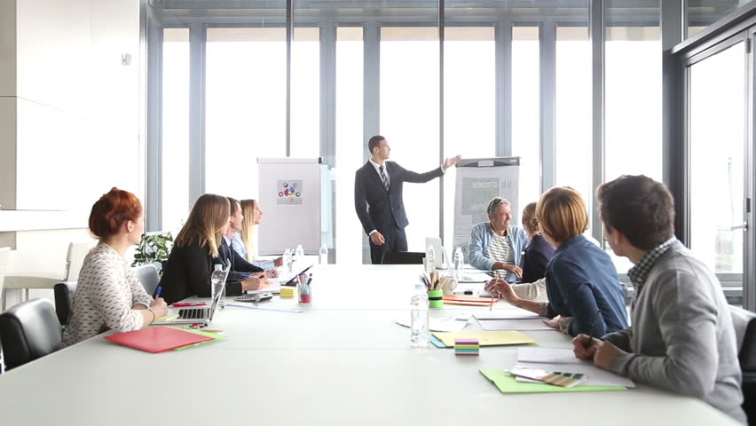 Young handsome director giving a motivational speech to colleagues in conference room | Shutterstock HD Video #15414610