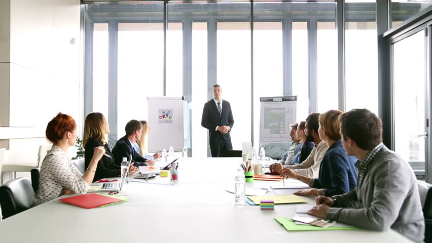 Business people applauding director during a meeting in conference room, graded | Shutterstock HD Video #15414820