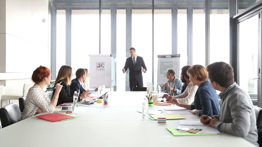 Business people applauding director during a meeting in conference room | Shutterstock HD Video #15414859