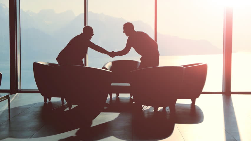 business meeting of two professionals in modern lobby lounge at sunset. panoramic window view background #15415501