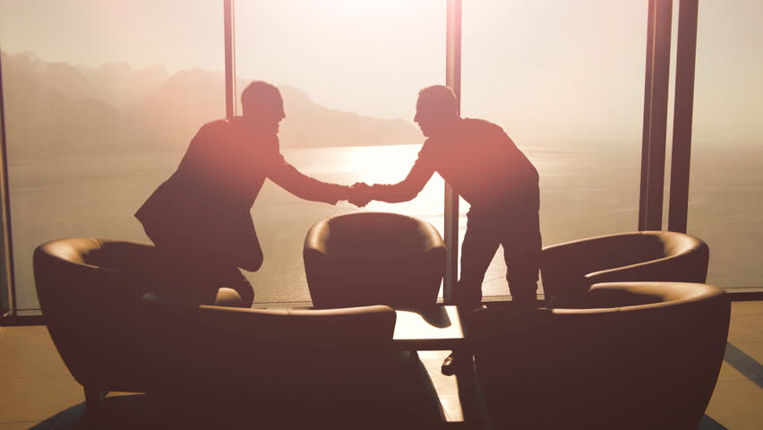 business meeting of two professionals in modern lobby lounge at sunset. panoramic window view background #15415528