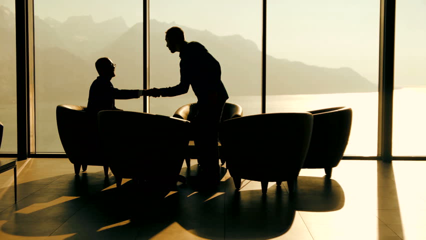 business meeting of two professionals in modern lobby lounge at sunset. panoramic window view background #15415579