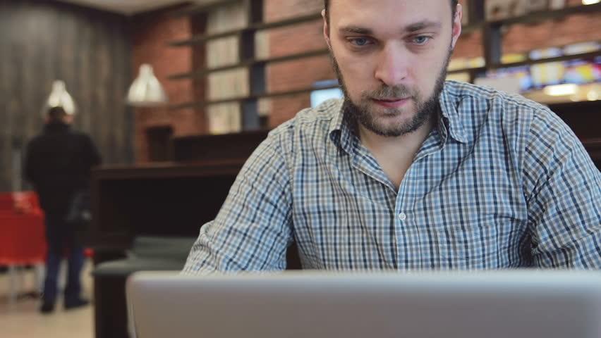 Man working on laptop in cafe. static  | Shutterstock HD Video #15416704