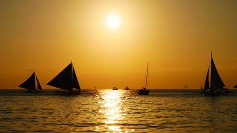 Sailing boats at sunset UHD