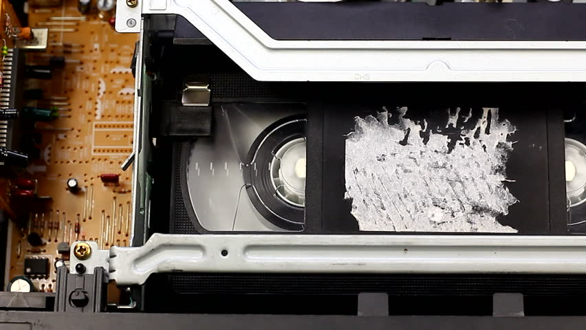 Playing video cassette on VCR VHS | Shutterstock HD Video #15430480