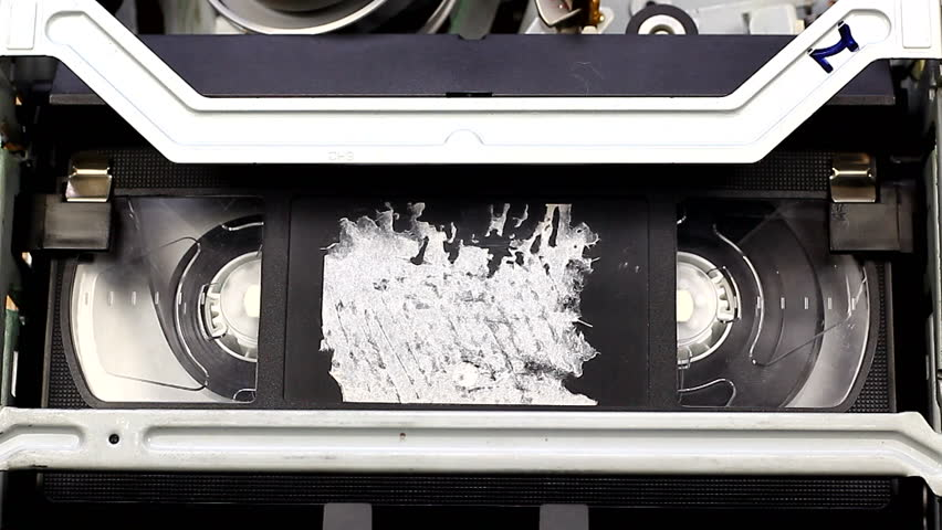Playing video cassette on VCR VHS | Shutterstock HD Video #15430483