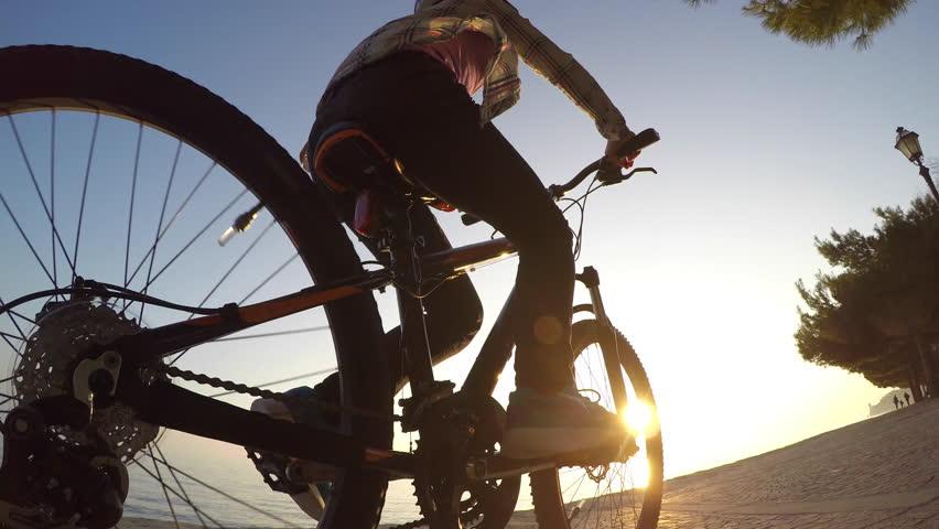 Girl riding bike at sunset