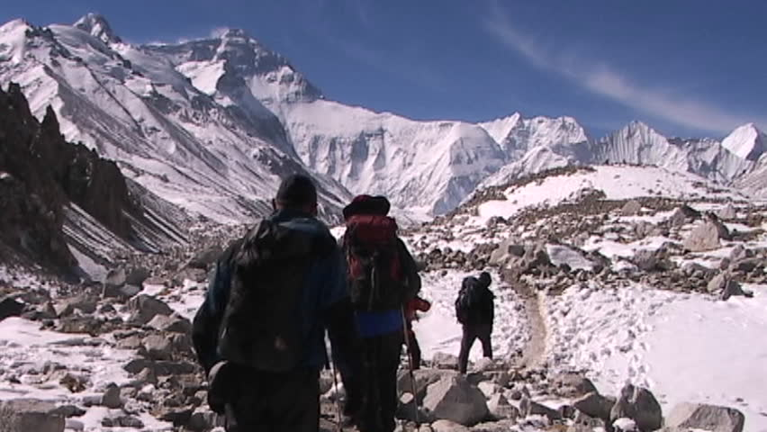 Climbers leaving base camp walking towards the North Face of Mt. Everest