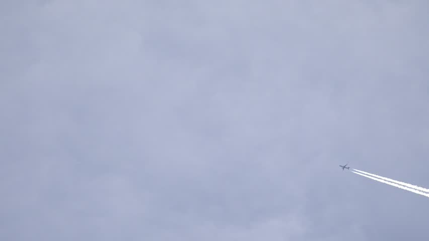 4K White trail of plane on blue sky, commercial jet by day | Shutterstock HD Video #15460819
