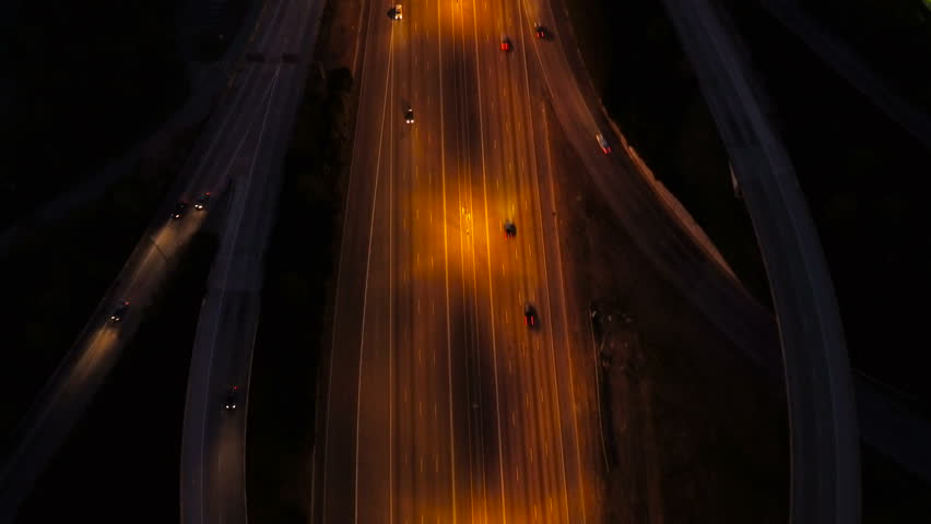 Atlanta Aerial v228 Vertical shot following over Spaghetti Junction freeways at night.