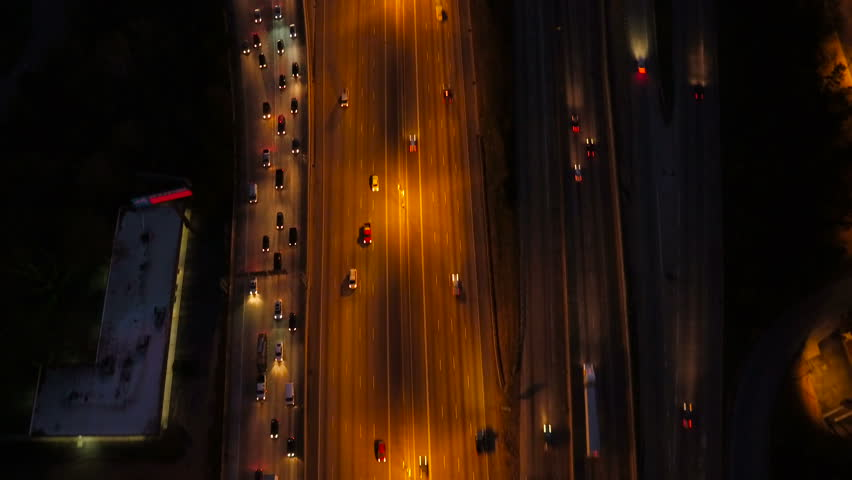 Atlanta Aerial v229 Vertical shot following over Spaghetti Junction freeways panning up to cityscape dusk views.